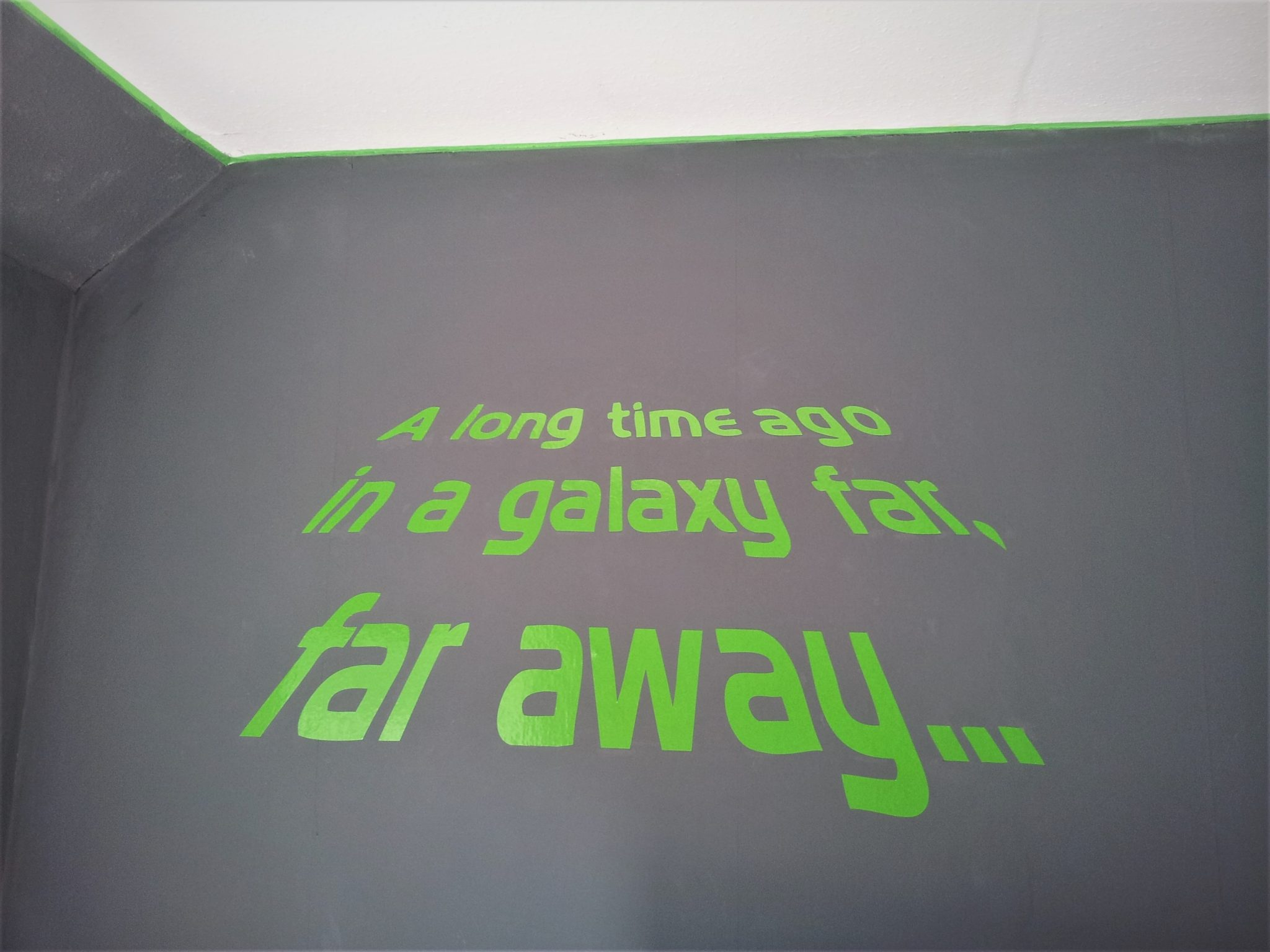 "Star Wars Bedroom Makeover - lime green wall sticker on a grey wall that says ""A long time ago in a galaxy far, far away..."""