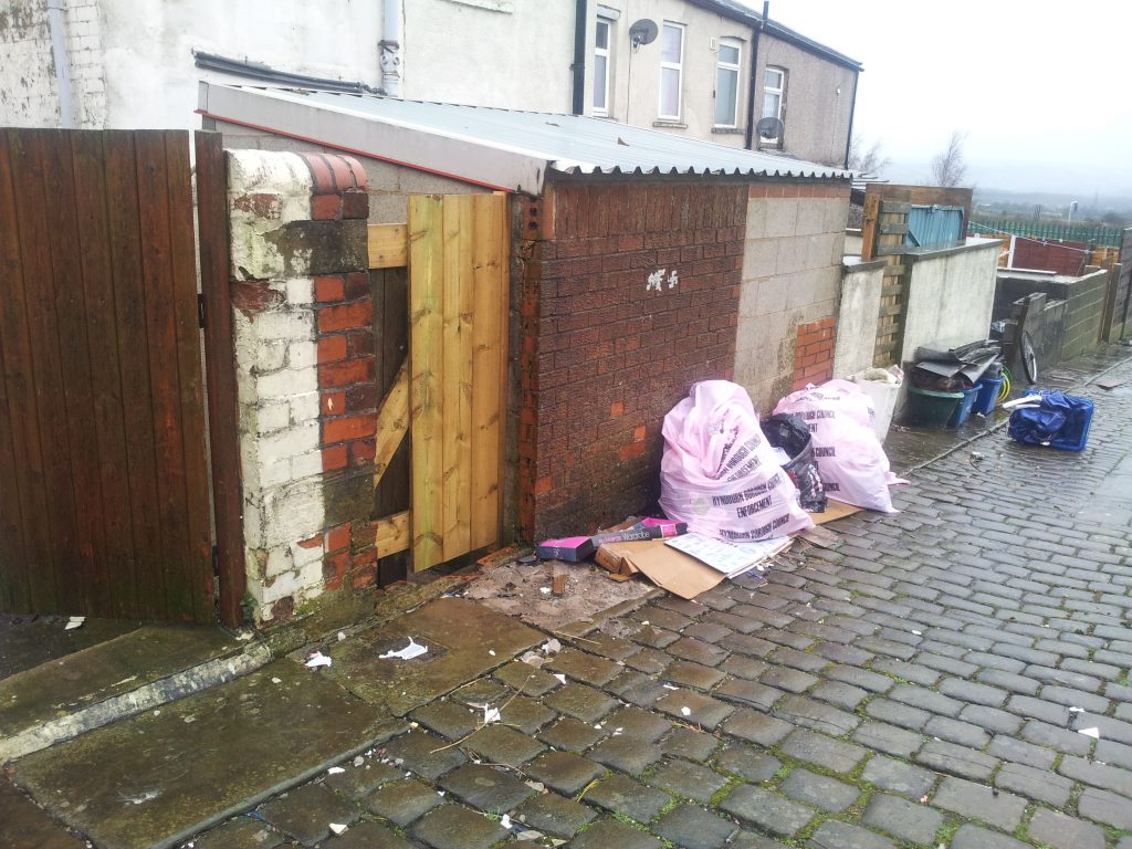 Fly-tipping in an alley: the British towns where houses are too cheap