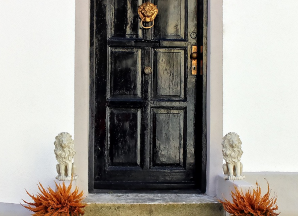 Black front door. 40 questions to ask when buying a house.