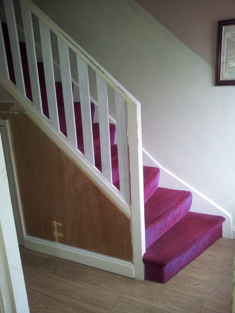 Our staircase and hallway before renovating it - want to see what we did to improve it?