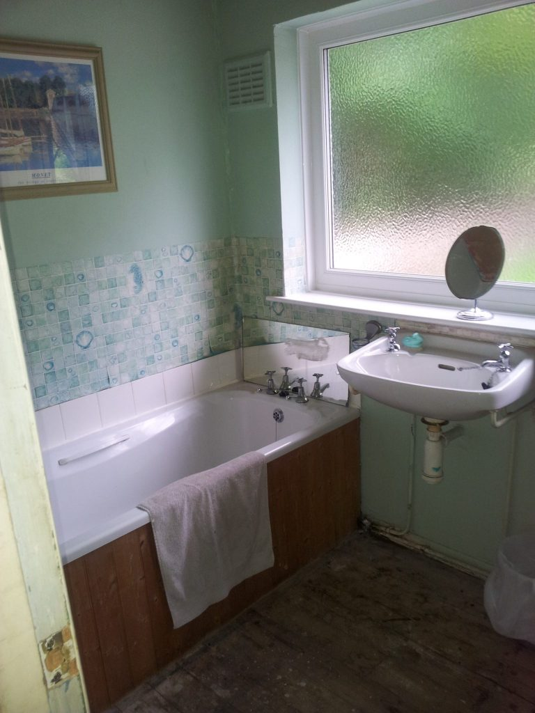 Our bathroom, before we gutted and renovated it. Want to see what it looks like now?