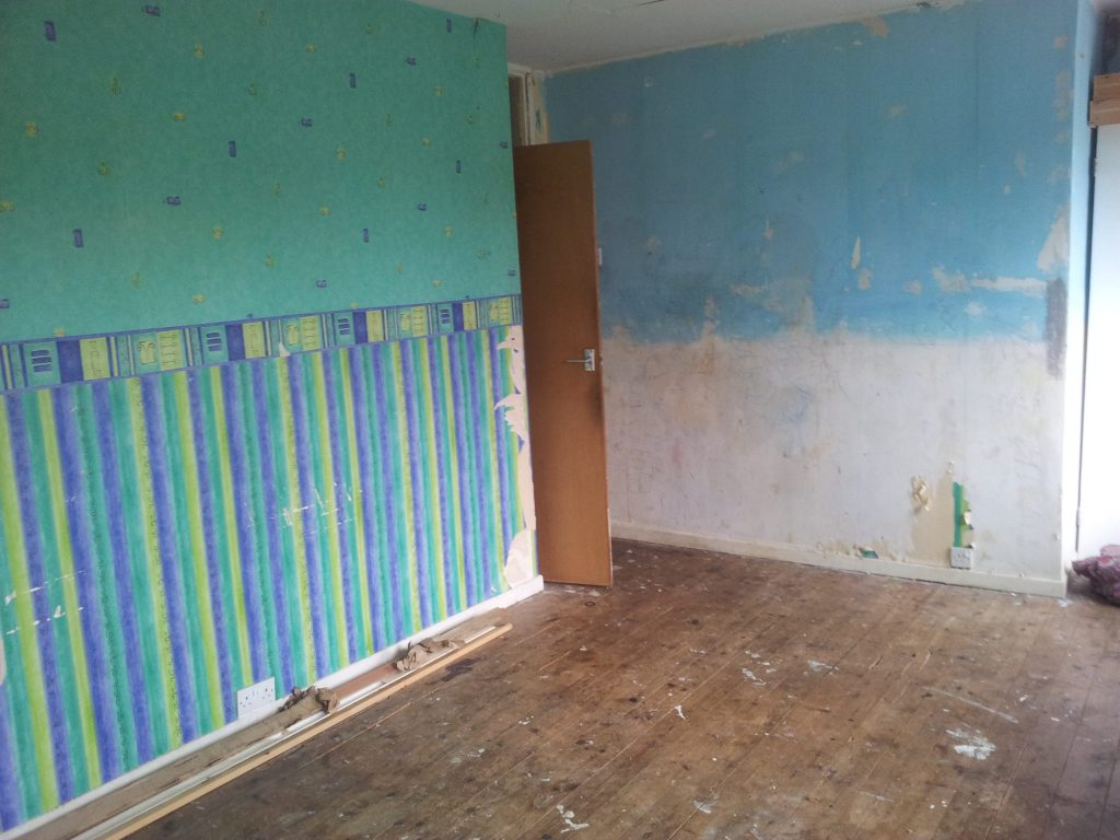 Our bedroom before renovating it. Want to see what it looks like now?