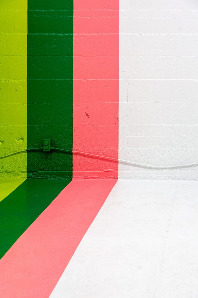 Lime, green and pink stripes on wall and floor.