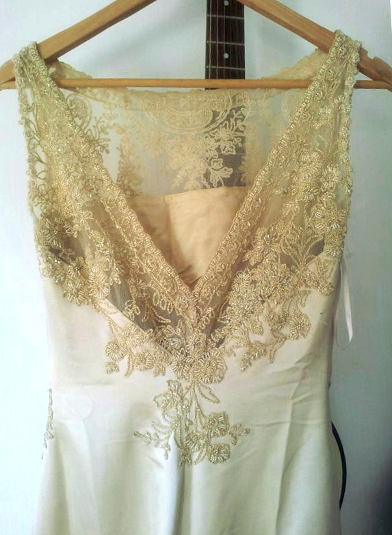 Gold Pronovias sample wedding dress with lace back.