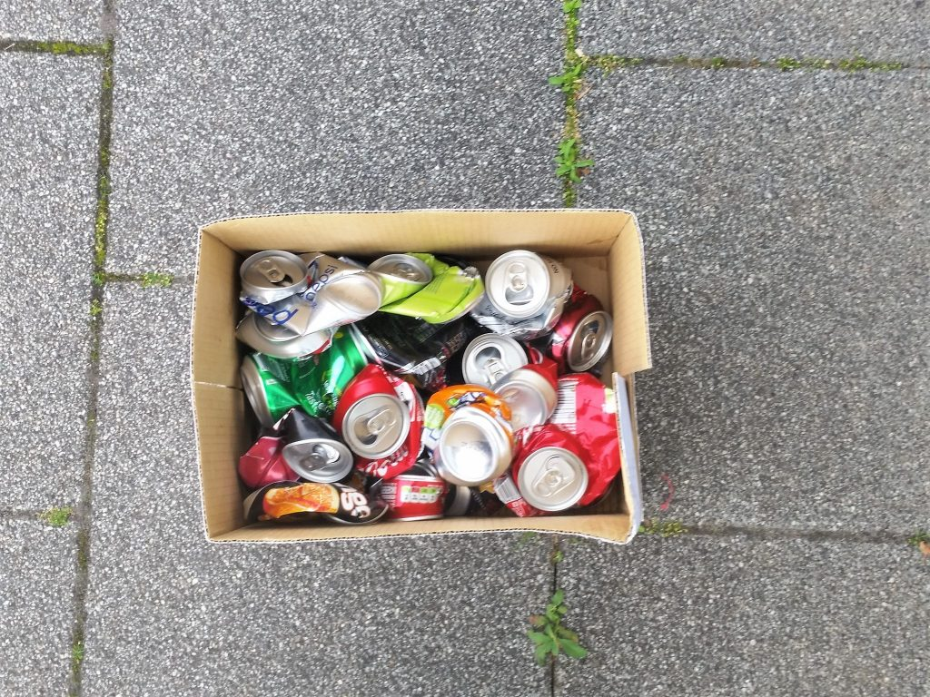 Collecting aluminium cans for melting.