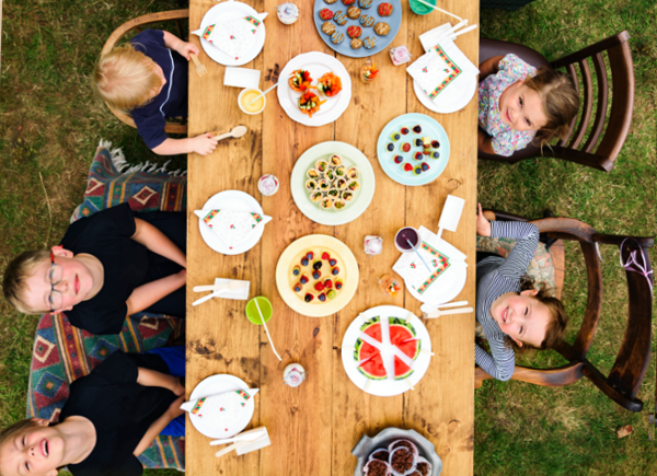 Kids enjoying garden party | How to plan a kids' party on a budget